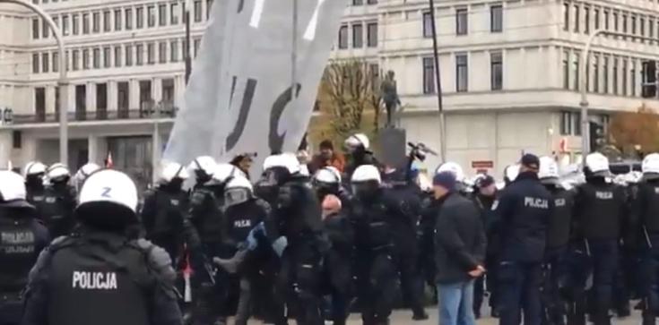 Lider Obywateli RP zakłócał marsz. Wyprowadziła go policja - zdjęcie